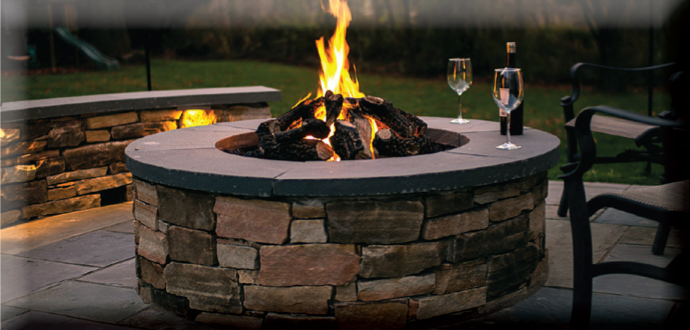 custom fire pit by DiSabatino Landscaping