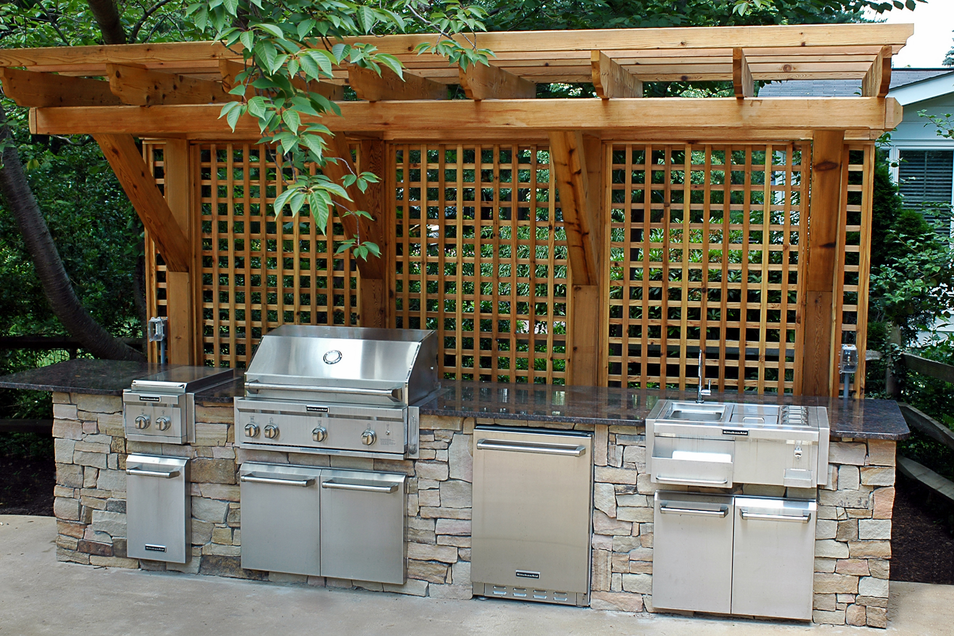Foley After__Wilmington, DE 19807 - Outdoor Kitchen by DiSabatino Landscaping & Esposito Masonry