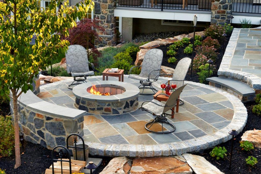 Round Slate Patio with stone firepit and stone walls MILLER - artisan masonry