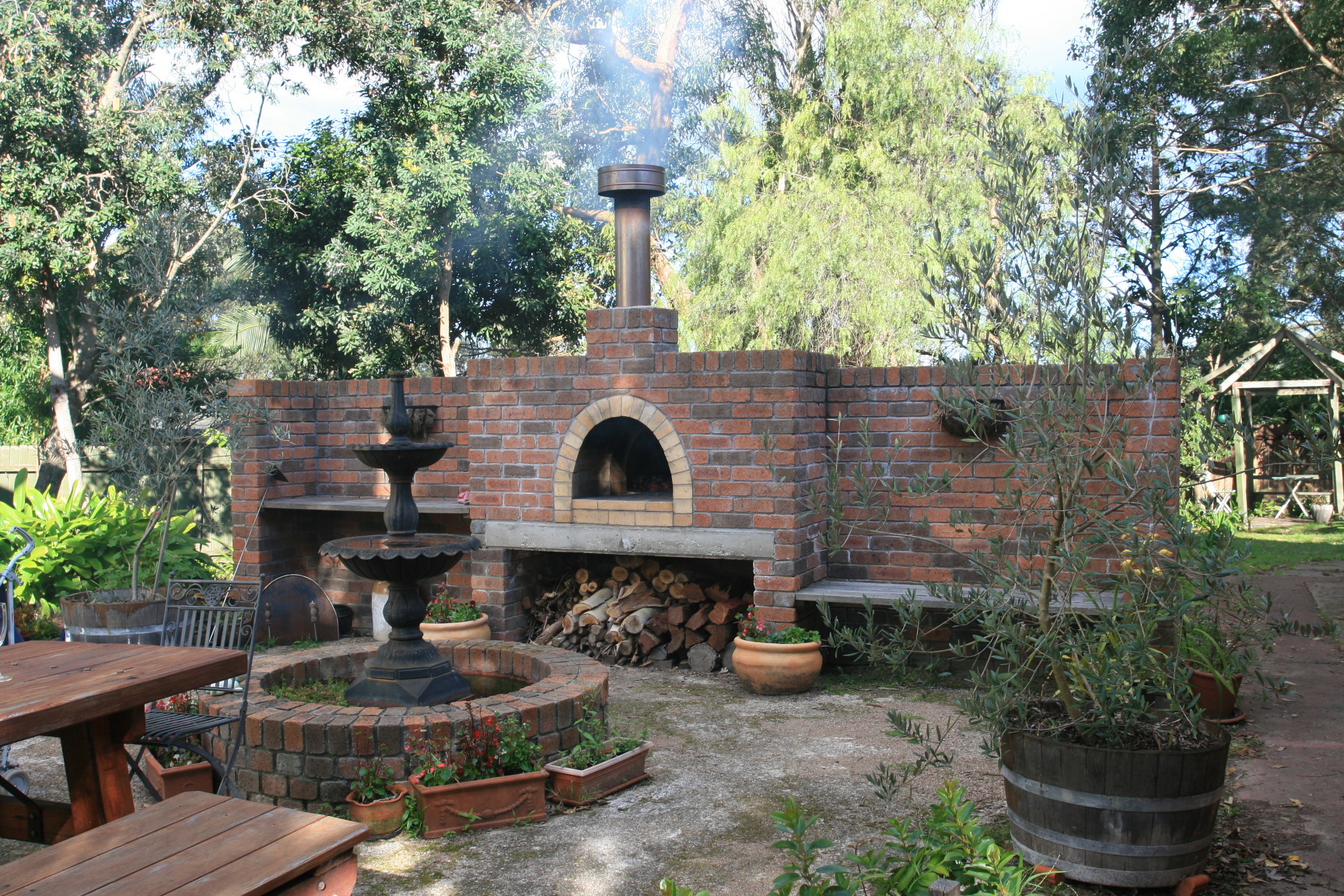 outdoor brick pizza ovens and fountain